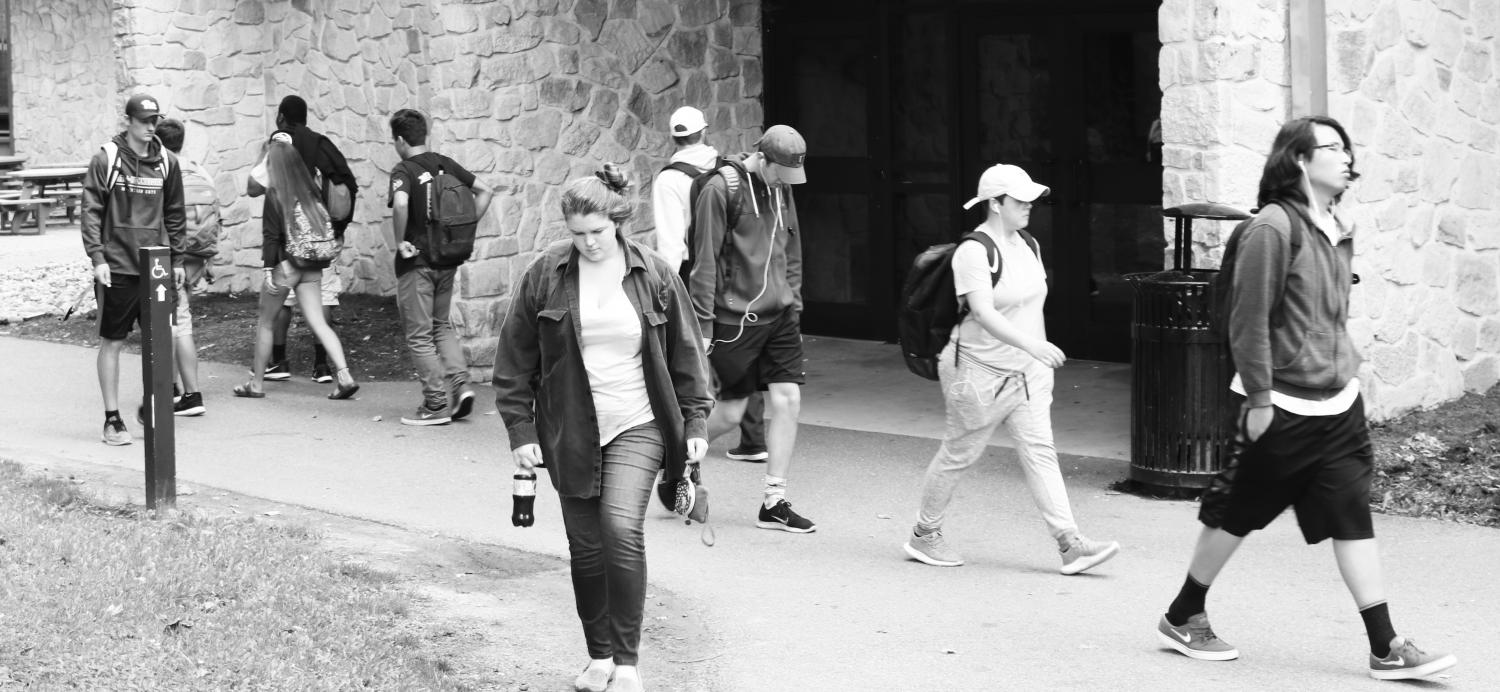 Students walk past the Student Union, which soon may become more branded with school pride.