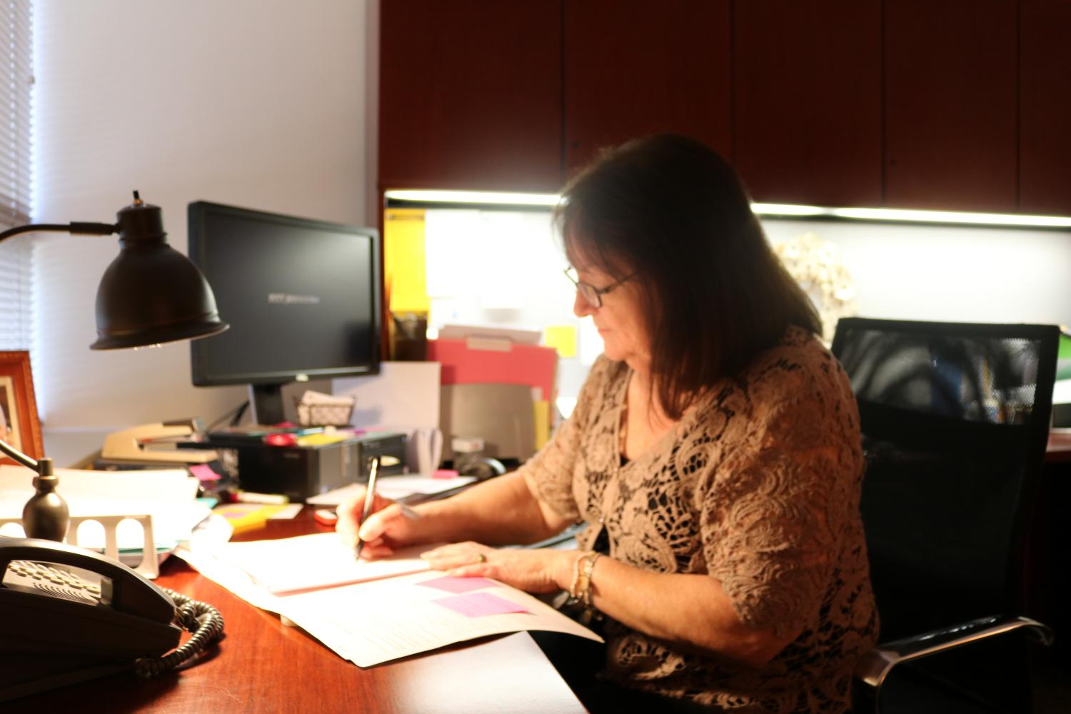 Health and Counseling Director Shelley Peruso works at her desk in the Student Union's Health Services Office.