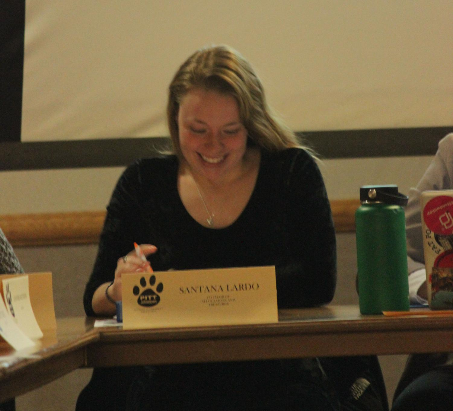 Student Government Treasurer Santana Lardo announces the emergency funds for this year at last week's student government meeting.