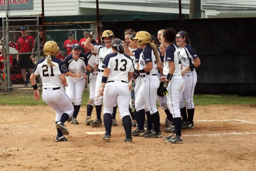 Pitt-Johnstown softball team members celebrate a home run hit by Amanda O'Toole against Edinboro University March 25 last year at V.E Erickson Field in Richland Township.