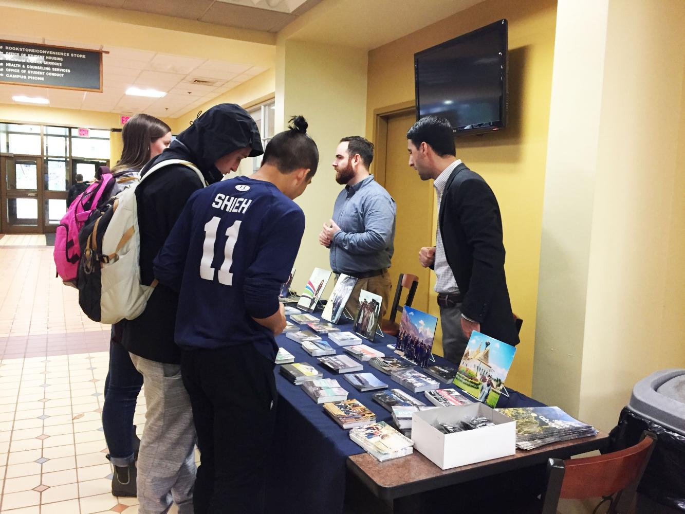 Students talk to study abroad representatives at a fair Oct. 11 on the Student Union's second floor.