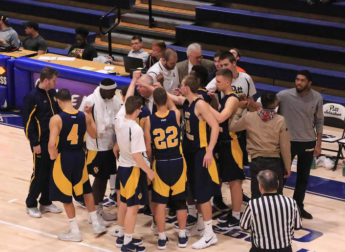 Pitt-Johnstown huddles before a game against East Stroudsburg Nov. 19 when they lost 88-99.