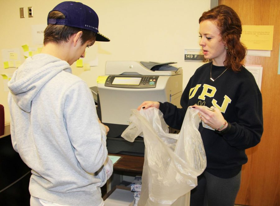 Bridge-transition program student Justin Gorden and Pitt-Johnstown junior Janna Shober collect recycling in Biddle Hall.