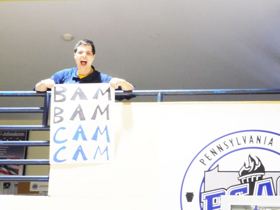 "Volleyball fan Spencer Kale holds his ""Bam Bam Cam Cam"" sign in support of the team."