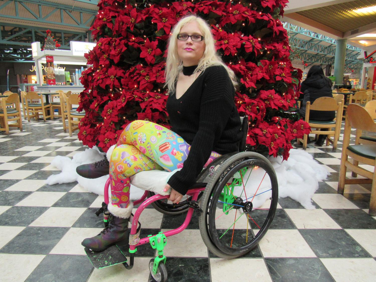 Barb Zablotney, of Windber, plans to compete in Ms. Wheelchair Pennsylvania, a beauty pageant for disabled women.  Here, she poses at the Galleria mall food court.