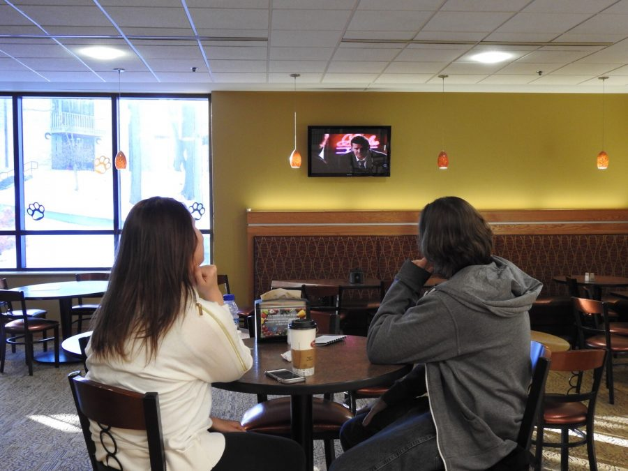 Students Abigail Moran (left-right) and Trevor Belding watch TV near Brioche Dorée cafe in the Student Union. Internet protocol television is to be installed by March 6.