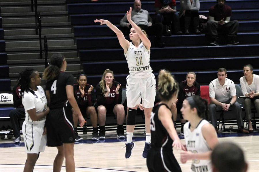 Olivia+McCabe+attempts+a+two-point+shot+against+Indiana+%28Pa.%29+University+Jan.+4+at+the+Sports+Center.+McCabe+scored+her+1%2C000th+point+in+a+Jan.+6+game+against+Gannon+University.