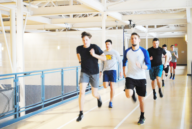 Pitt-Johnstown track runners practice at the Wellness Center last week for their meet Saturday.