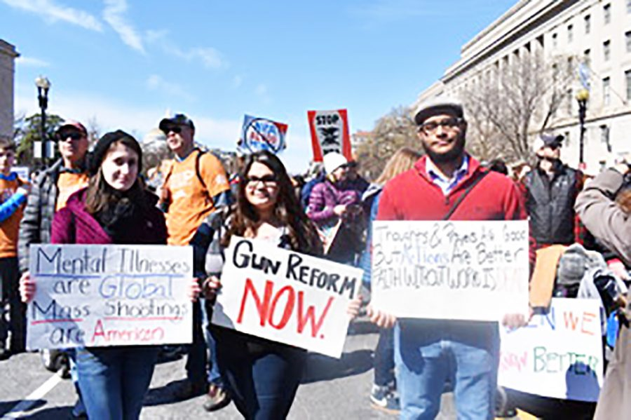 Junior Kristy Speranza, freshman Maddie Brown and sophomore Chris Nichols brought signs to the national March for Our Lives last Saturday.