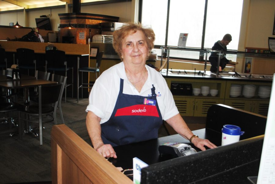 Sodexo+worker+Helen+Ferrante+stands%2C+ready+with+a+smile%2C+to+swipe+students+into+the+Student+Union+dining+hall.+