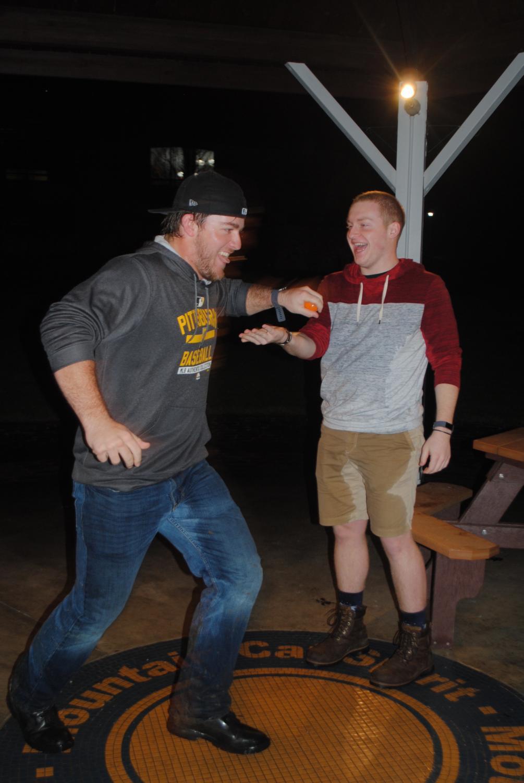 Baseball catcher Mason Prickett snatches an egg out of Reid Walter's hand.