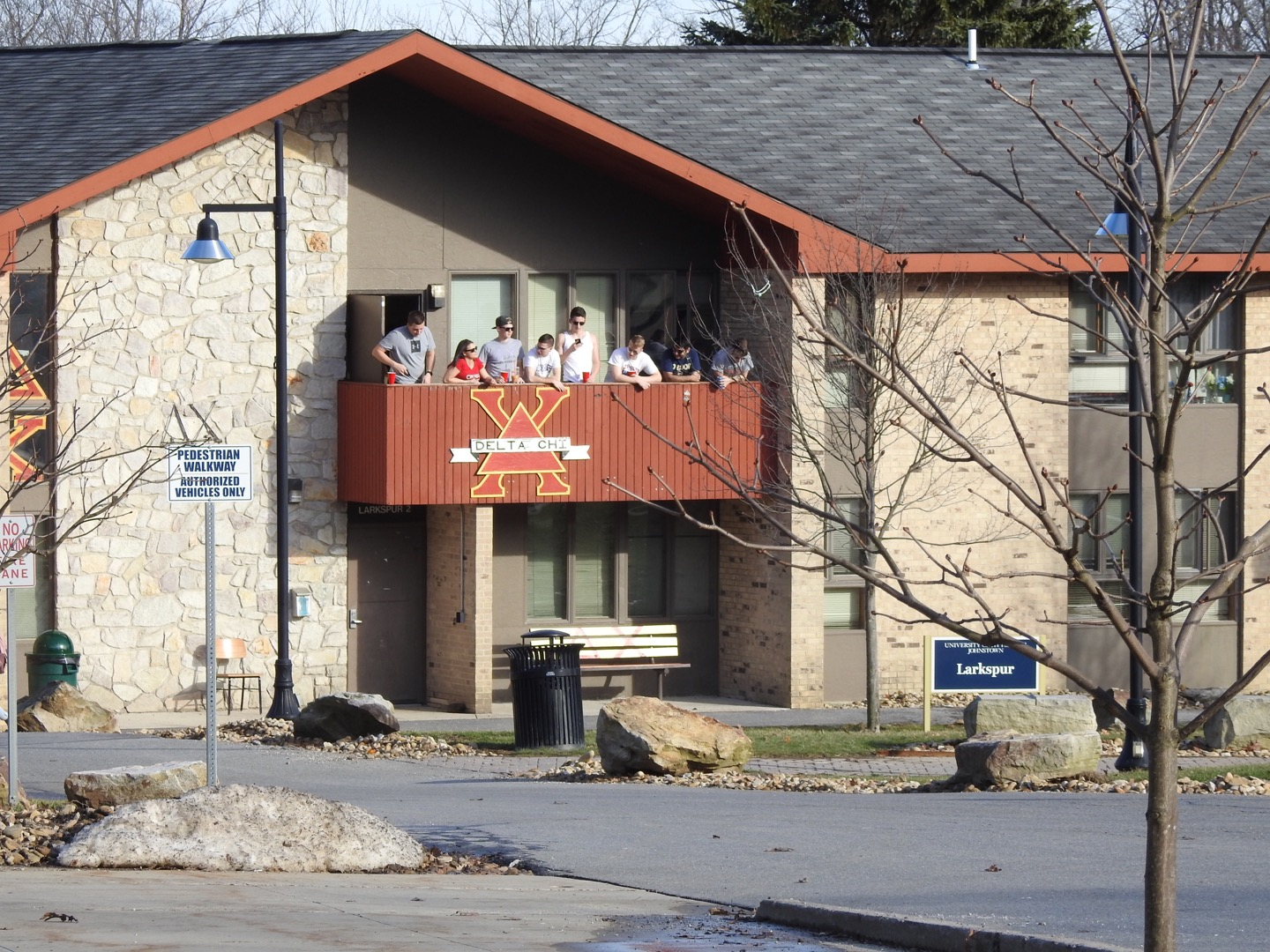 Students gather Feb. 20 at Delta Chi's Larkspur Lodge balcony. Students can now place a bid with a Greek organization after participating in a workshop.