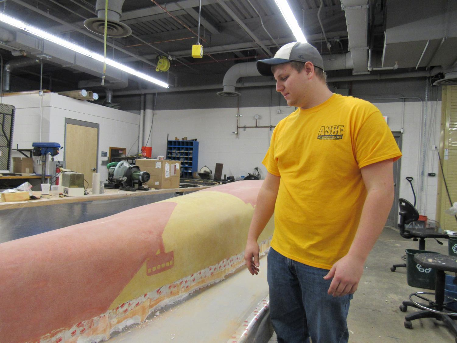Concrete Canoe captain Justin Towsey shows off canoe progress as of early March.