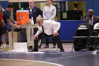 Wrestling coach Pat Pecora observes a bout against Mercyhurst last season, telling wrestlers what to do during the match.