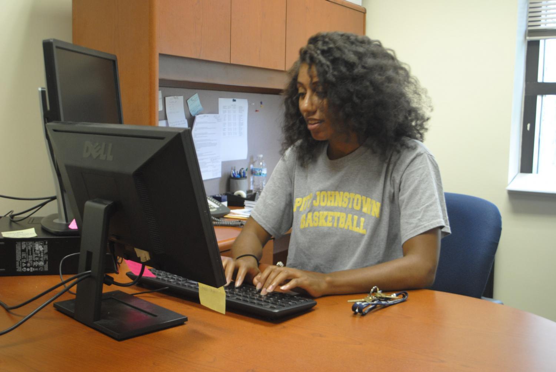 Renee Brown, international services director, works at her office desk.