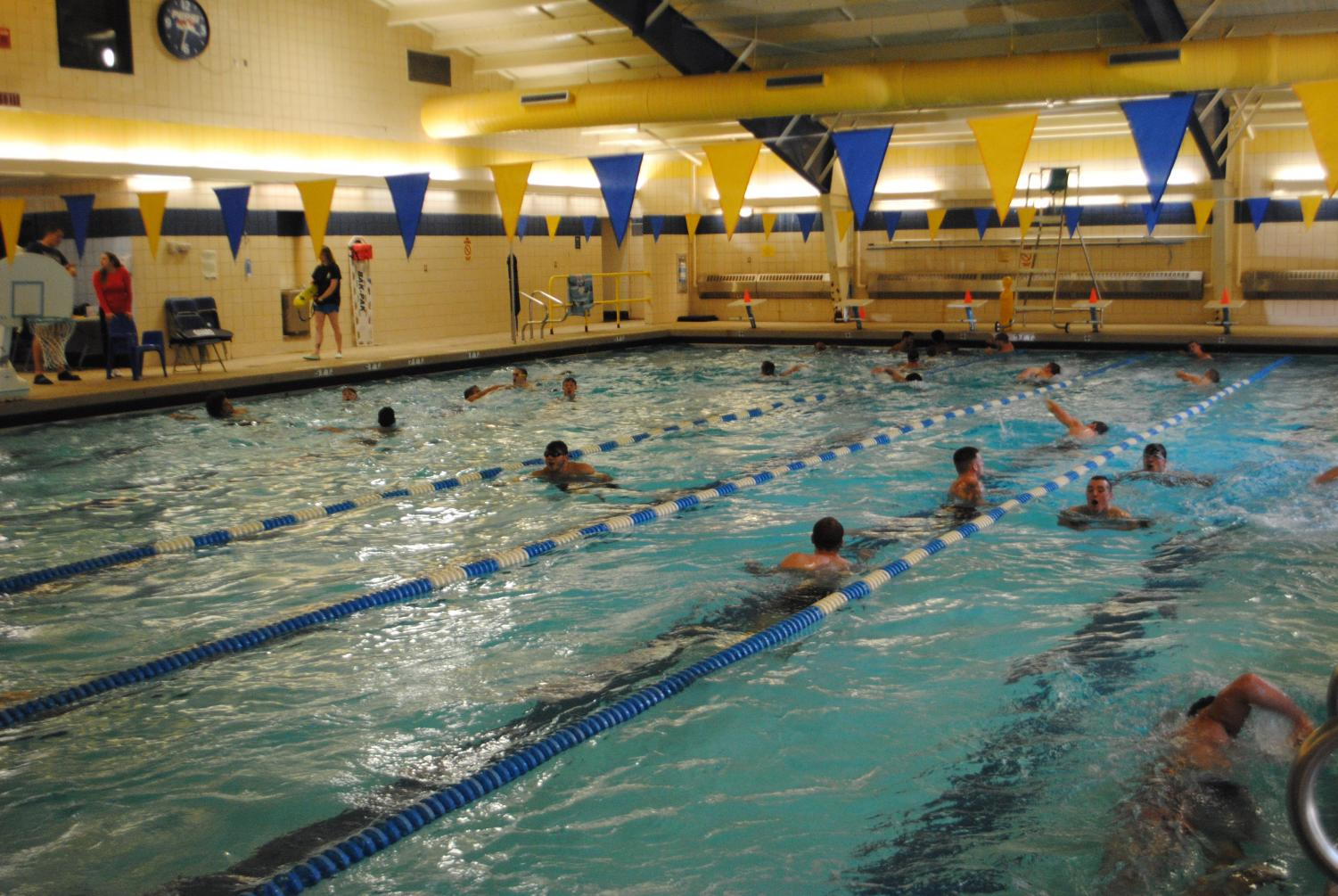 Wrestlers swim laps last Wednesday for their practice at the Zamias Aquatic Center. They usually swim about 35 laps. The laps are one of three parts of their Wednesday workouts.