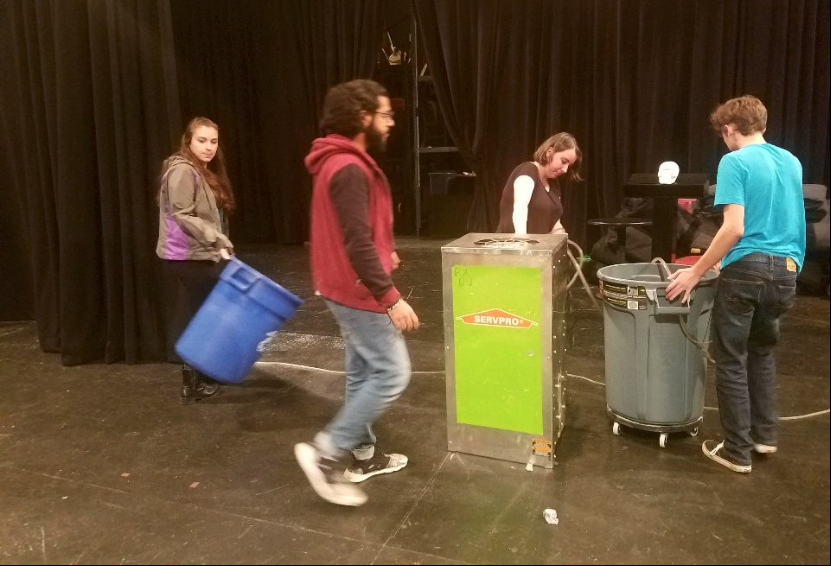 Senior+Erin+Whyte+and+sophomores+Muneer+Al-Busaidi+and+Laken+Burkhardt+clear+dehumidifiers+and+buckets+from+the+studio+theater+before+the+fall+play%E2%80%99s+first+rehaearsal.+