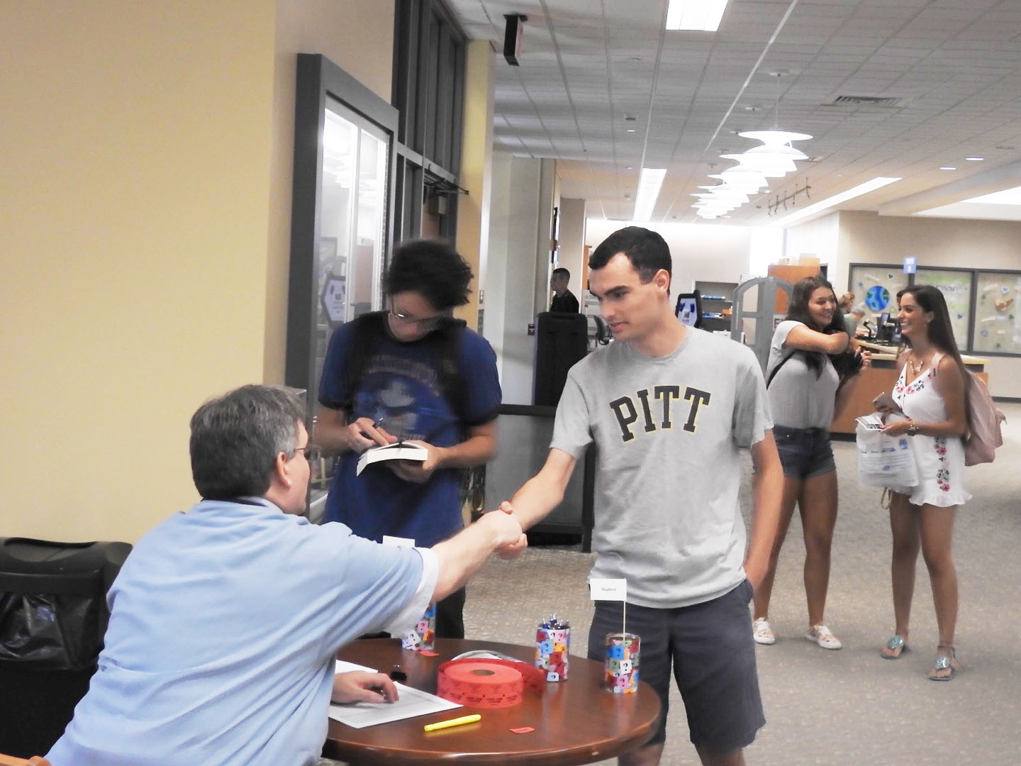 Sophomore Matt Stark shakes hands with Owen Library director Peter Egler at an Aug. 30 open house. Egler said that, eventually, all students will go through the personal-librarian program during their first year.