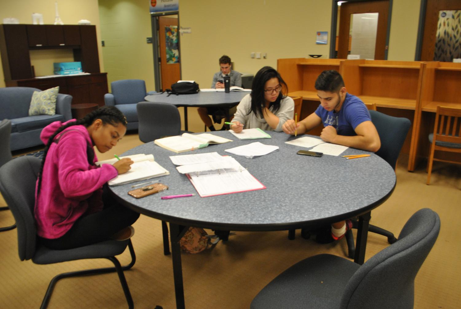 (Left to right) Students Jordyn Ford, Kaila Yuazon and Muhammad Quraishy work on math problems at drop-in tutoring in the Academic Success Center last week.