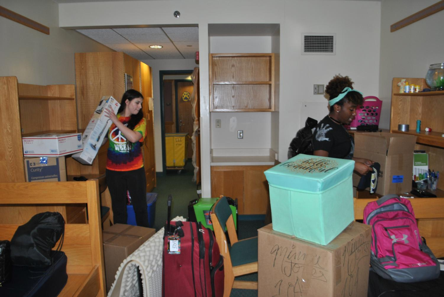 Sophomores Brittney Cesari (left) and Minnie Jones (right) pack their belongings Oct. 7 out of their first-floor Living/Learning Center room.