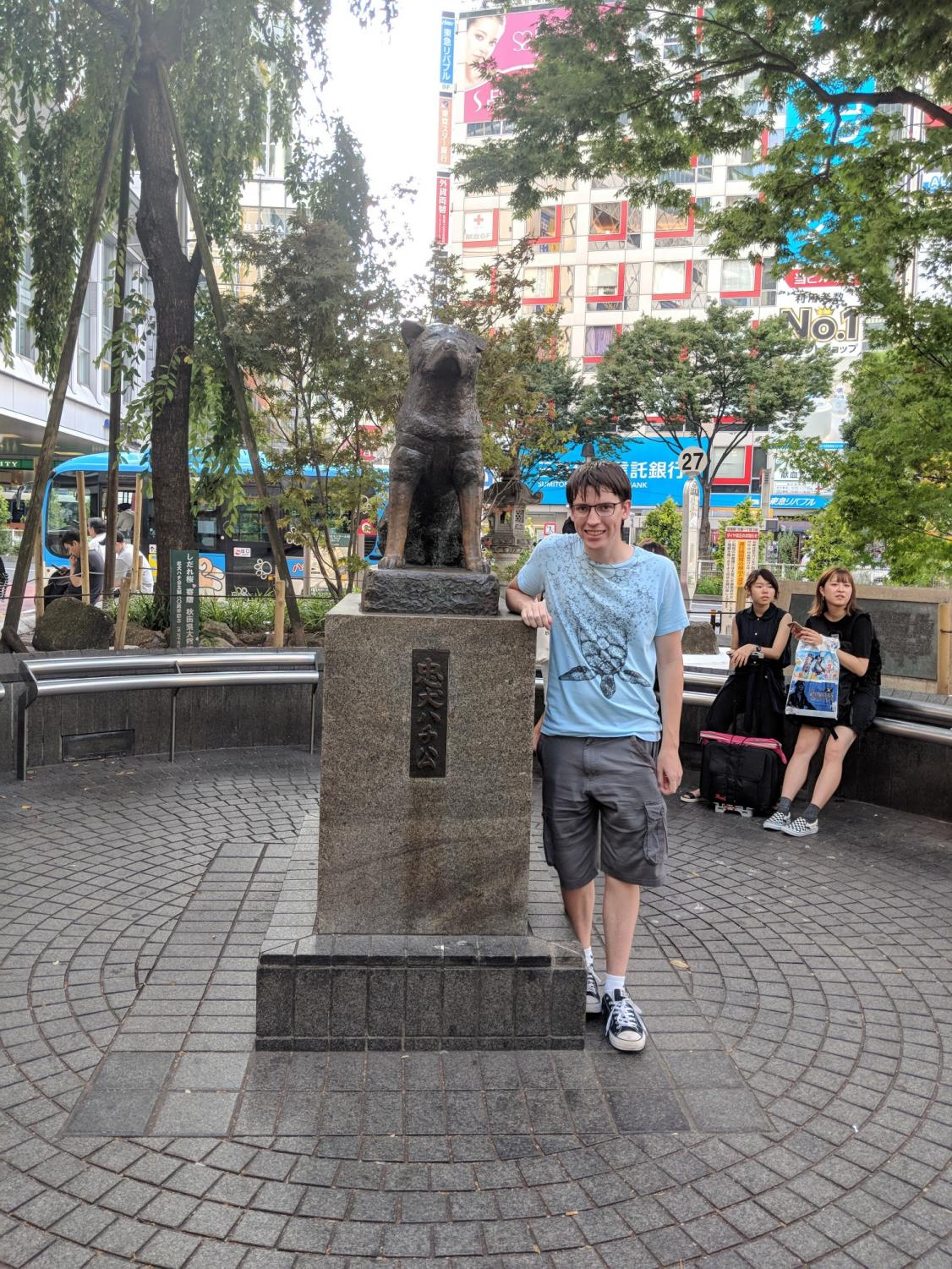 Junior Ryan Wasil poses with a Hachiko dog statue at Shibuya Train Station in Japan, where he studied abroad this summer.