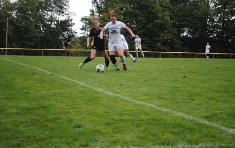 Abby LaDuke (center, white) battles with a Millersville soccer player for ball control Sept. 8 at the Soccer Field.