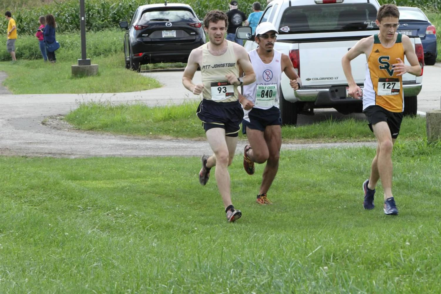 Junior Connor Harriman (left) runs in the St. Vincent's Invitational on Sep. 15 in Latrobe, Pa.