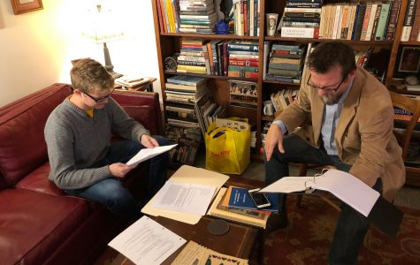 """Senior Sam Miller (left) reads his lines for a major role in """"Canfessional,"""" a film in three parts that history professor Paul Newman (right) wrote and is directing for entry in film festivals."""