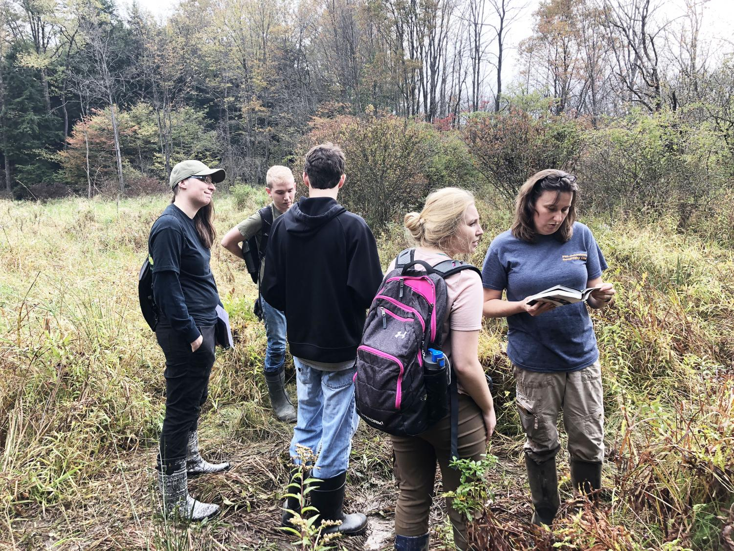 Students work with geography professor Mitzy Schaney (right) to identify vegetation Oct. 4.