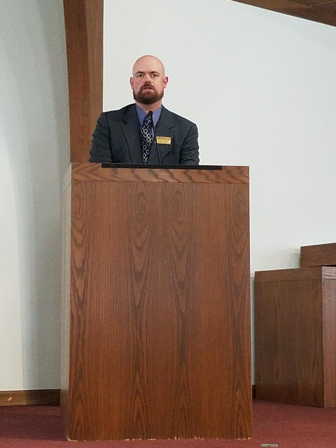 Minister Brad Dayton urged those attending a memorial service Oct. 31 to act in love and support after a shooting Oct. 27.