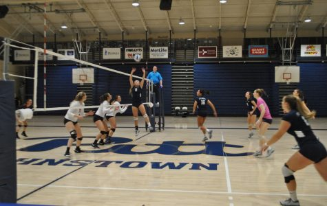 Sophomore J.C. Longeville (No. 2, center) sets the ball for her teammates in the volleyball team's first round conference playoff game agsinst California (Pa.) University last Wednesday at the Sports Center. The volleyball players lost 2-3.