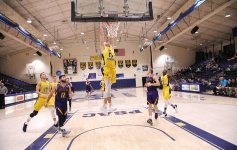 Freshman Caiden Landis (15) dunks the basketball in a game against Carlow University on Nov. 28 at the Sports Center. The team dominated, the game, winning 129-69.