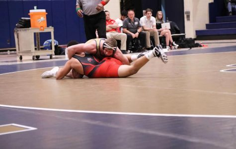 Brock Biddle holds his opponent at a Jan. 11 bout at the Sports Center against East Stroudsburg.