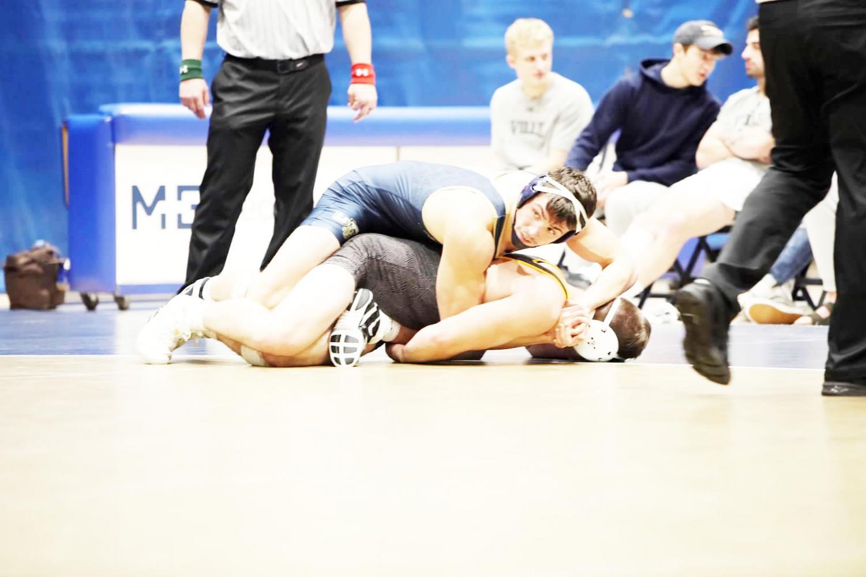 Pitt-Johnstown Junior Alex Delp rides his opponent on Nov. 16 against Millersville University. | Photo: Ali Single