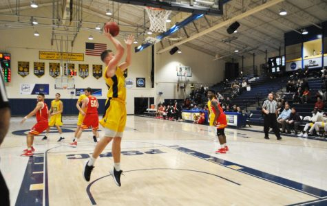 Marcin Wiszomirski dunks with no opposing players under the backboard against Seton Hill University on Saturday at the Wellness Center in a 64-86 losing effort.