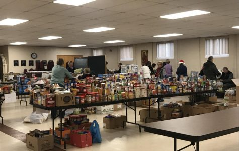 Members of local churches organize supplies donated to the St. Vincent de Paul Soup Kitchen.  The groceries were given to local this past Christmas season.     Photo courtesy of LaDonna McCrary