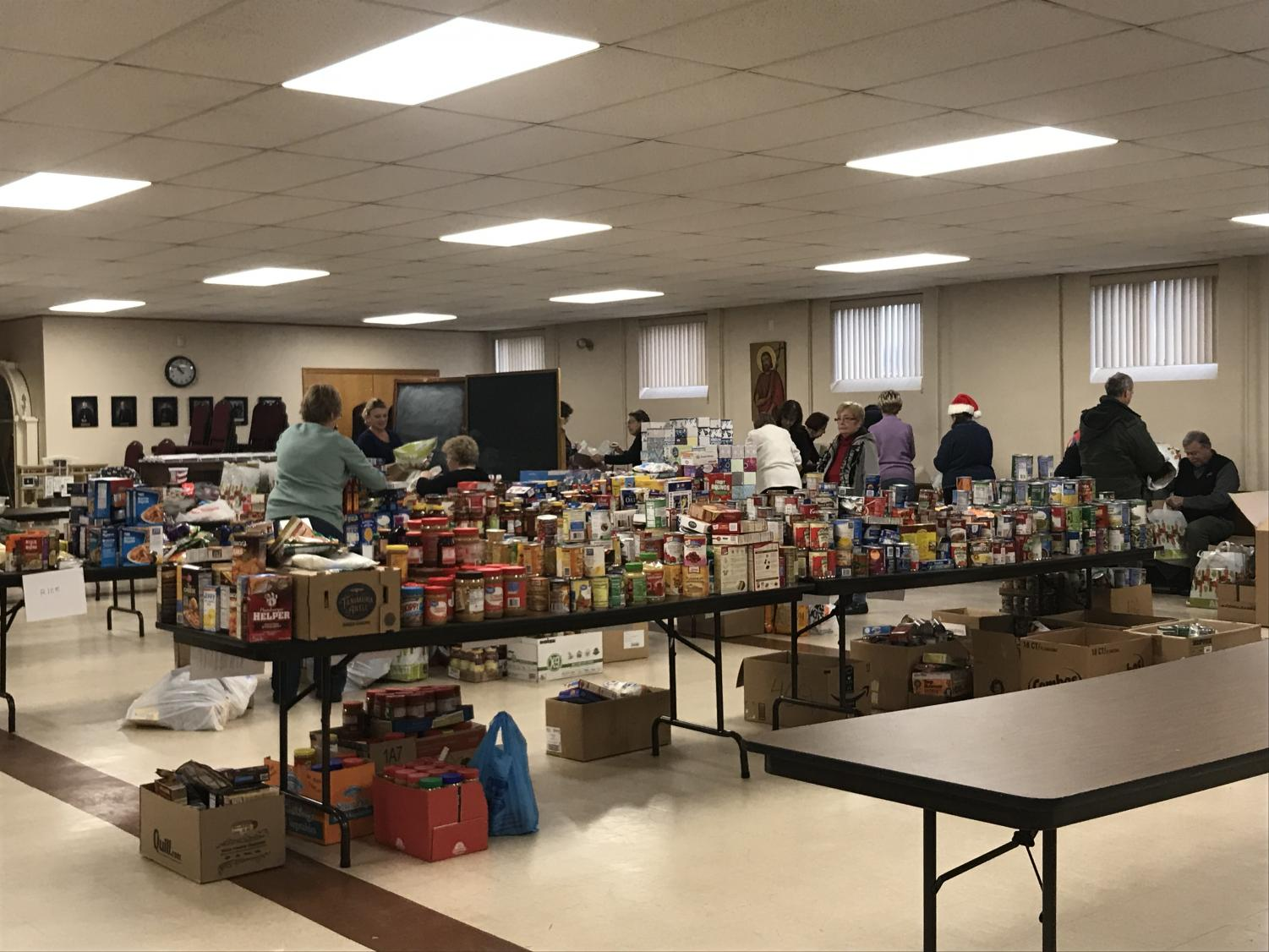 Members of local churches organize supplies donated to the St. Vincent de Paul Soup Kitchen.  The groceries were given to local this past Christmas season.   | Photo courtesy of LaDonna McCrary
