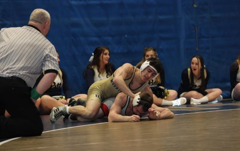 Joey Alessandro pushes his opponent during a Friday bout at the Sports Center against Seton Hill University. Pitt-Johnstown won 23-14 in the match.