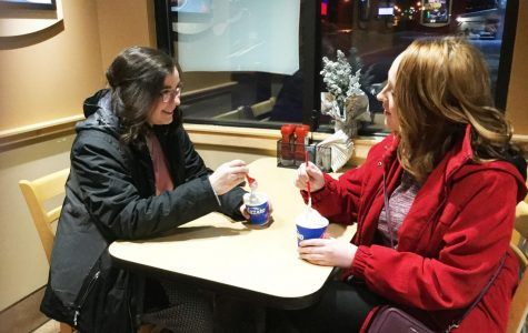 Juniors Jaymie Harclerode (left) and Mikayla Haggerty (right) eat Blizzards from the Dairy Queen along Scalp Avenue.  Dairy Queen is one of the Pitt Stop locations that offer discounts for Pitt-Johnstown community members.