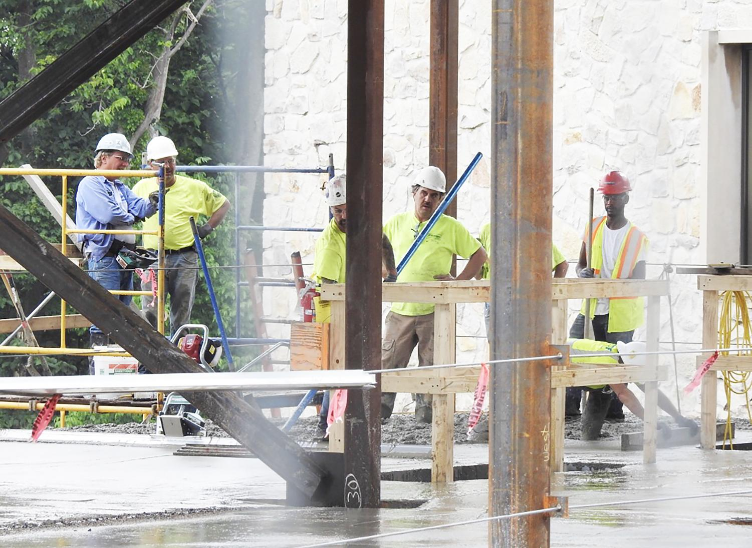 Massaro Corp. workers consider their work during July construction of the John P. Murtha Engineering and Science building's chemical enginnering addition. The construction was to be finished by Jan. 1, but campus officials have said that it will wrap up soon.