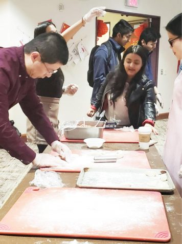 Students make dumplings under instruction at a Feb. 4 Chinese New Year celebration at Pitt-Bradford.  | Photo courtesy of Wang Yaxuan.