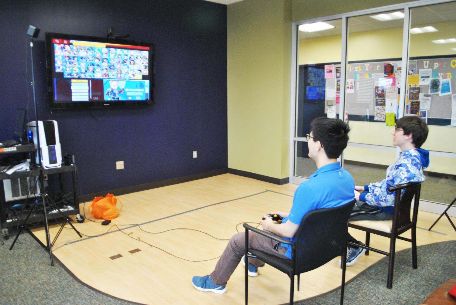 """Sophomore Stephen Lui and junior Ryan Wasil play """"Super Smash Bros. Ultimate"""" in the Student Union's Zone arcade room Feb. 15."""