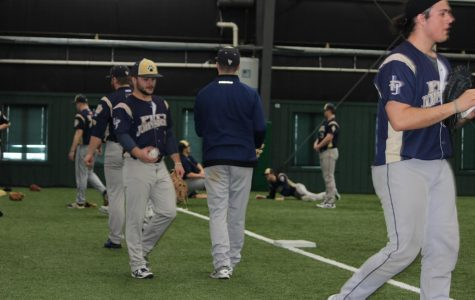 Men's baseball team members work out Jan. 28 at the Iron Horse Baseball Complex, preparing for their first competition.