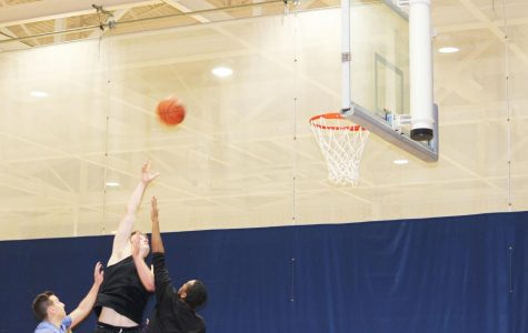 Matt Holsinger shoots the ball against two oppenents at the three vs three basketball helping Melo is Trash winning the game Jan. 28 in the Wellness Center.