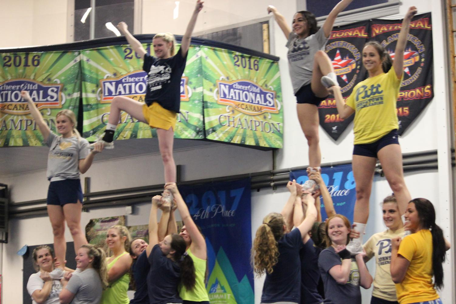 Pitt-Johnstown cheerleaders prepare Feb. 13 for The National Cheerleaders Assocaition competition at Turner's All-Star Cheerleading.