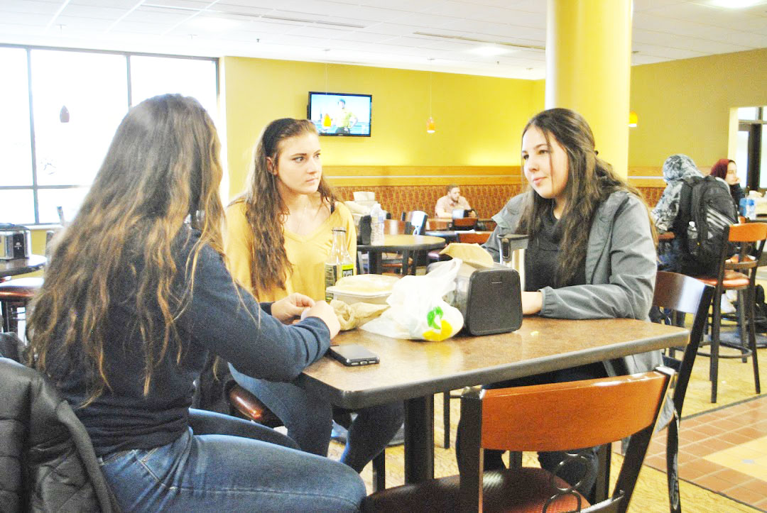 Sophomore Tessa Fry (left), junior Emily Kaczmarek (center) and sophomore Isa Lanthaler (right) hang out in the Student Union on Feb. 8.