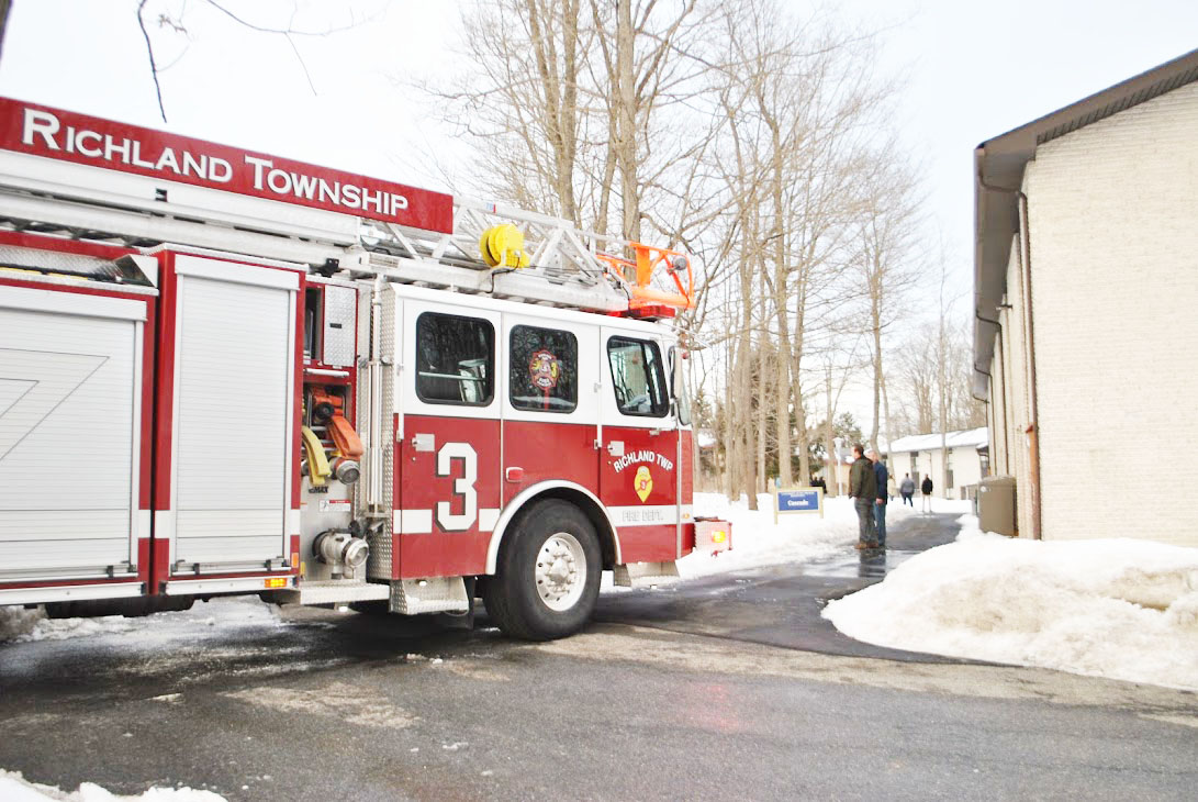 A Richland Township firetruck drives down Townhouse pathways last Thursday after wires sparked inside the attic of Woodland Manor apartment 7.