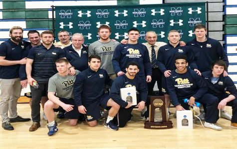 Pitt-Johnstown wrestlers pose with their regional trophy after winning their regional tournament Feb. 23 in Erie, Pa.