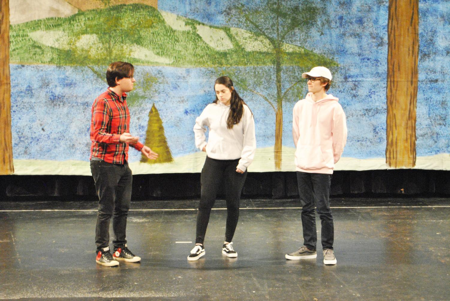 "Senior Benjamin Berkebile (left), junior Renee Riley (center) and junior Jarod Shark (right) rehearsed last Wednesday for ""A Midsummer Night's Dream."""