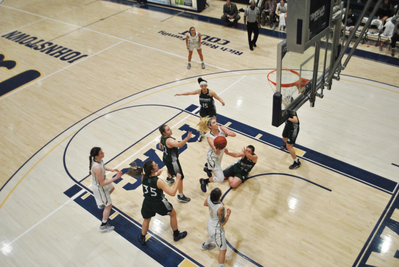 Gabbie Smith (center) scored 19 points, against Mercyhurst University Feb. 27 at the Sports  Center.
